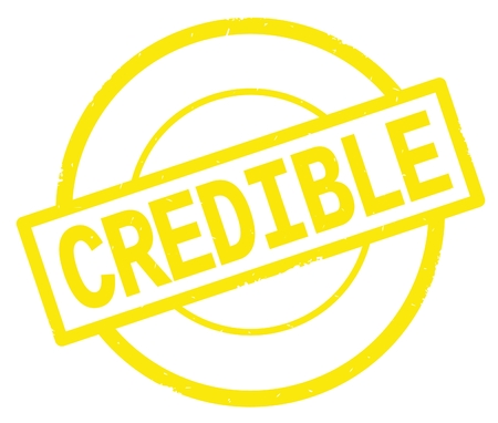 CREDIBLE text, written on yellow simple circle rubber vintage stamp.