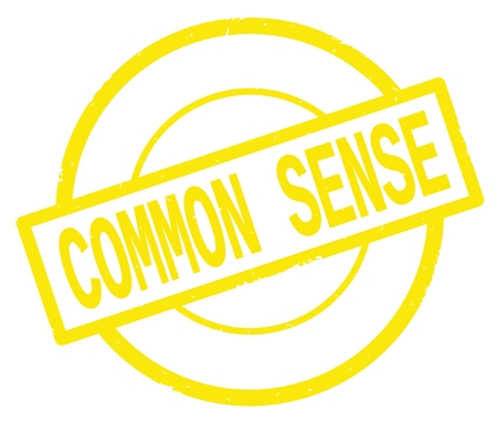 COMMON SENSE text, written on yellow simple circle rubber vintage stamp. Stock Photo