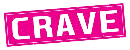 CRAVE text, on full pink rectangle vintage textured stamp sign. Stock Photo