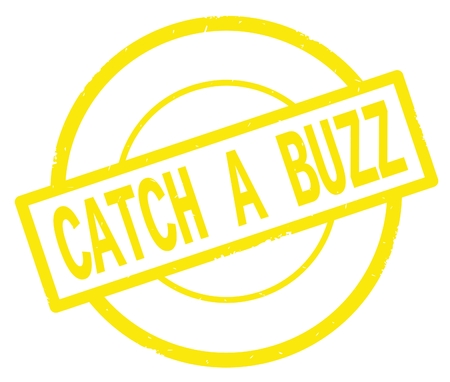 CATCH A BUZZ text, written on yellow simple circle rubber vintage stamp. Imagens