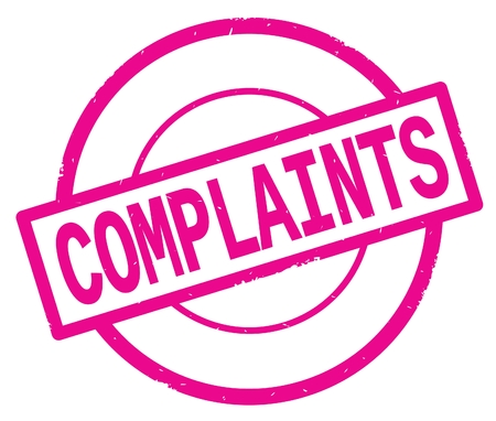 COMPLAINTS text, written on pink simple circle rubber vintage stamp.