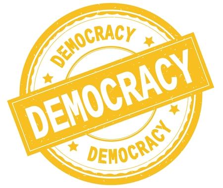 DEMOCRACY , written text on yellow round rubber vintage textured stamp. Stock Photo