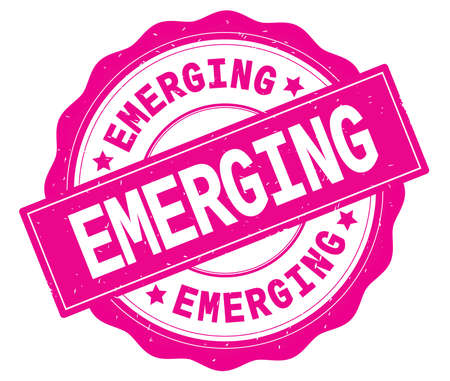 EMERGING text, written on pink, lacey border, round vintage textured badge stamp. Stock Photo
