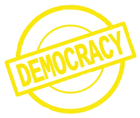 DEMOCRACY text, written on yellow simple circle rubber vintage stamp. Stock Photo