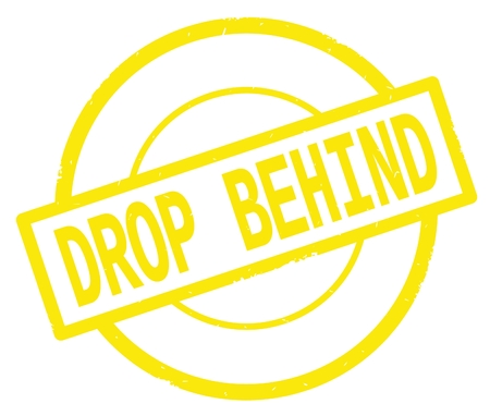 DROP BEHIND text, written on yellow simple circle rubber vintage stamp. 版權商用圖片