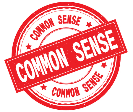 COMMON SENSE written text on red round rubber vintage textured stamp. Stock Photo