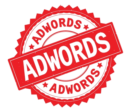 ADWORDS red text round stamp, with zig zag border and vintage texture.