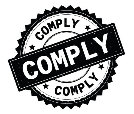 COMPLY black text round stamp, with zig zag border and vintage texture. Stock Photo