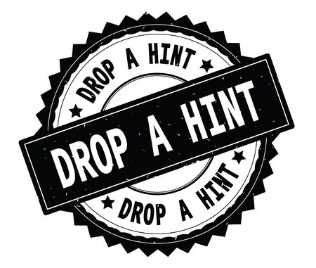 DROP A HINT black text round stamp, with zig zag border and vintage texture.