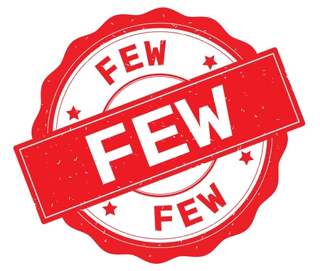FEW text, written on red, lacey border, round vintage textured badge stamp. Reklamní fotografie