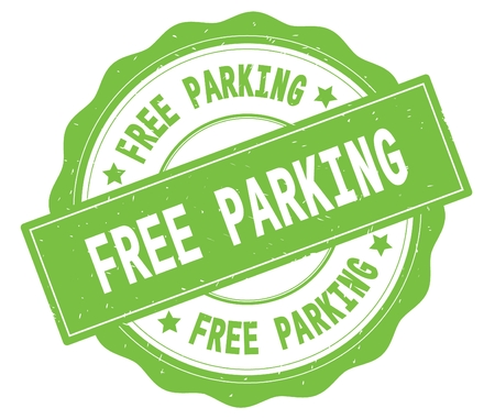 FREE PARKING text, written on green, lacey border, round vintage textured badge stamp.