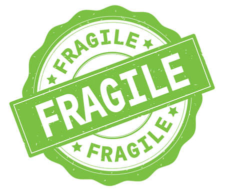 FRAGILE text, written on green, lacey border, round vintage textured badge stamp.
