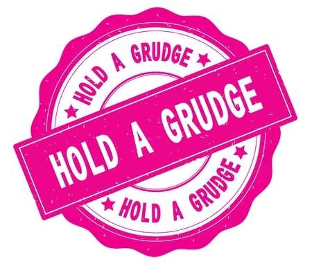 HOLD A GRUDGE text, written on pink, lacey border, round vintage textured badge stamp. Stock Photo