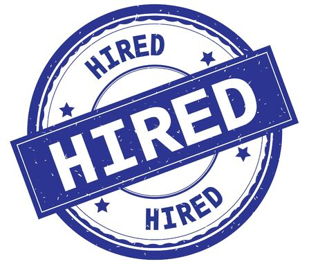 HIRED , written text on blue round rubber vintage textured stamp. Stock Photo