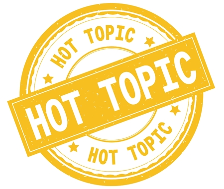 HOT TOPIC , written text on yellow round rubber vintage textured stamp.