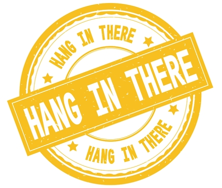 HANG IN THERE , written text on yellow round rubber vintage textured stamp.