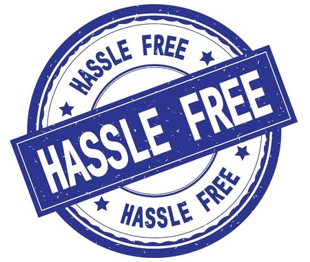 HASSLE FREE , written text on blue round rubber vintage textured stamp. Reklamní fotografie