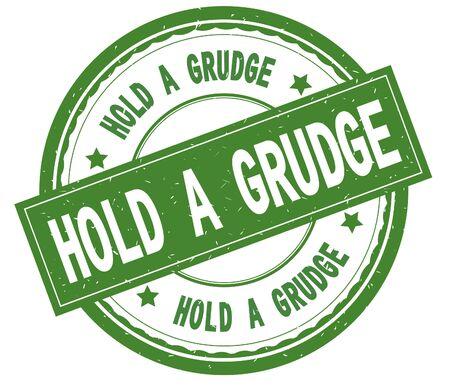 HOLD A GRUDGE , written text on green round rubber vintage textured stamp. Stock Photo