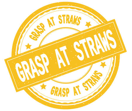 GRASP AT STRAWS , written text on yellow round rubber vintage textured stamp. Stock Photo