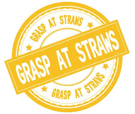 GRASP AT STRAWS , written text on yellow round rubber vintage textured stamp. 版權商用圖片