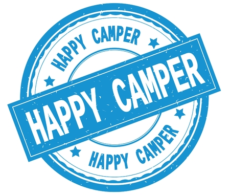 HAPPY CAMPER , written text on cyan round rubber vintage textured stamp. Stock Photo