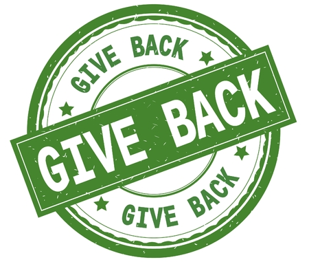 GIVE BACK , written text on green round rubber vintage textured stamp. Stock Photo