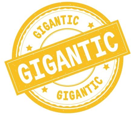 GIGANTIC , written text on yellow round rubber vintage textured stamp.