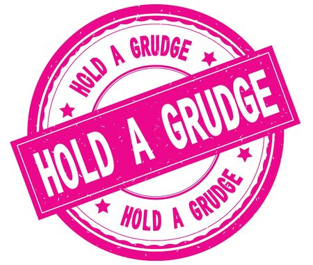 HOLD A GRUDGE , written text on pink round rubber vintage textured stamp.