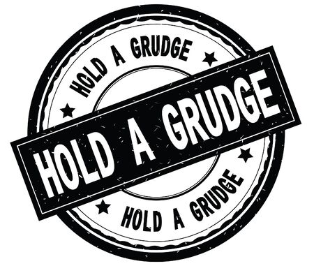 HOLD A GRUDGE written text on black round rubber vintage textured stamp.