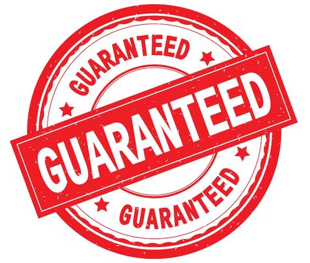 GUARANTEED written text on red round rubber vintage textured stamp. Stock Photo