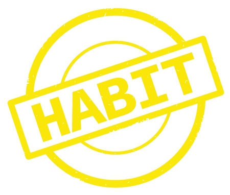 HABIT text, written on yellow simple circle rubber vintage stamp.