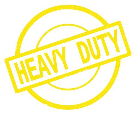HEAVY DUTY text, written on yellow simple circle rubber vintage stamp. Stock Photo