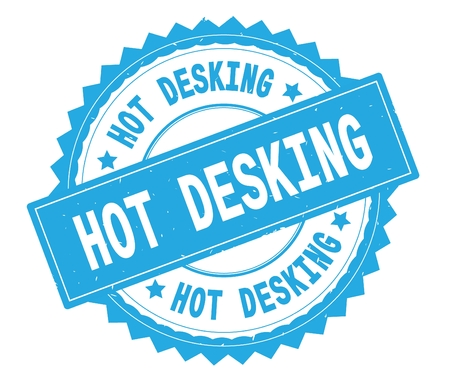 HOT DESKING blue text round stamp, with zig zag border and vintage texture.