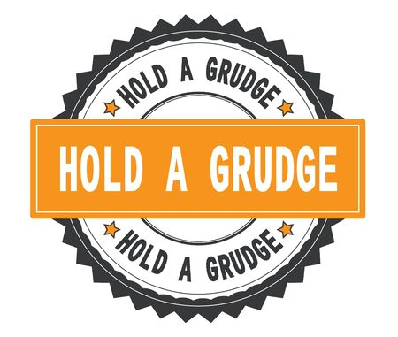 HOLD A GRUDGE text on grey and orange round stamp, with zig zag border and vintage texture. Stock Photo