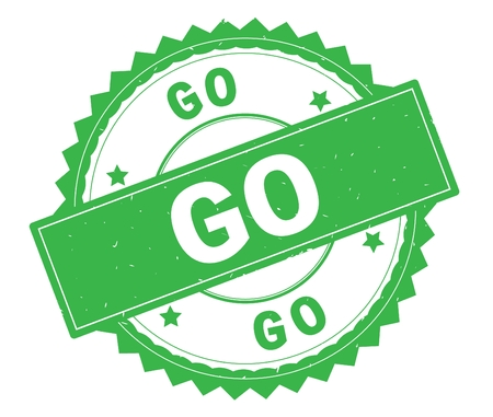 GO green text round stamp, with zig zag border and vintage texture. Stock Photo