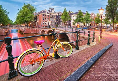 Amsterdam, The Netherlands. Colorful Hipster Bike on Bridge.