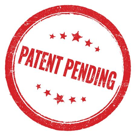 PATENT PENDING red grungy round stamp sign. Foto de archivo