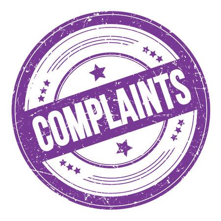 COMPLAINTS text on violet indigo round grungy texture stamp.