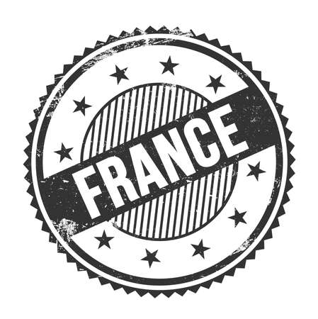 FRANCE text written on black grungy zig zag borders round stamp.