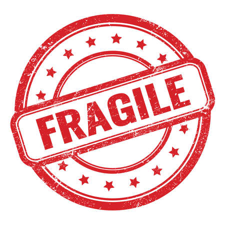 FRAGILE text on red grungy vintage round rubber stamp.