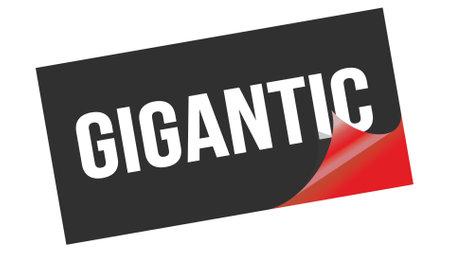 GIGANTIC text written on black red sticker stamp. 版權商用圖片