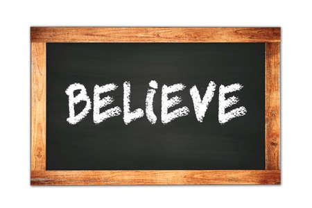 BELIEVE text written on black wooden frame school blackboard.