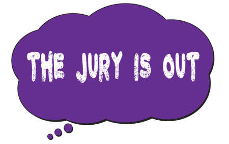 THE  JURY  IS  OUT text written on a violet thought cloud bubble. Standard-Bild - 167145147