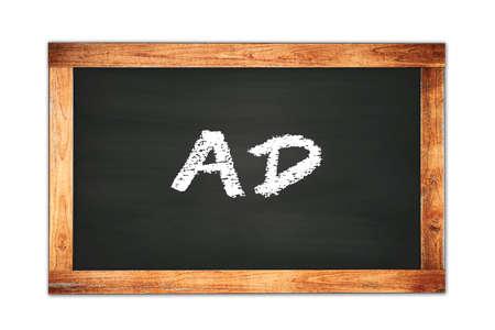 AD text written on black wooden frame school blackboard.