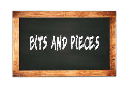BITS  AND  PIECES text written on black wooden frame school blackboard.