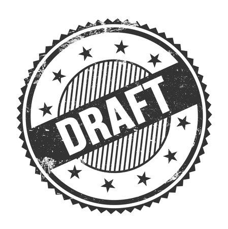 DRAFT text written on black grungy zig zag borders round stamp.