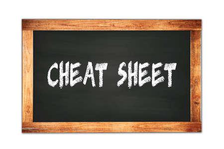 CHEAT  SHEET text written on black wooden frame school blackboard. 스톡 콘텐츠