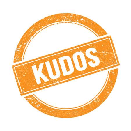 KUDOS text on orange grungy round vintage stamp. Stock Photo