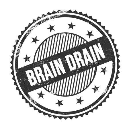 BRAIN DRAIN text written on black grungy zig zag borders round stamp.