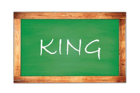 KING text written on green wooden frame school blackboard. Stock Photo